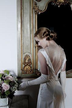 Backless vintage inspired wedding dress by http://www.sanyuktashrestha.com/