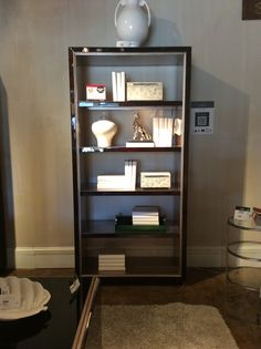 Elegant, modern and sophisticated with great attention to detail, the Jonathan Charles Belgravia Collection 5-tier etagere is made from a rich black eucalyptus wood, complimented by shiny nickel hardware and a silver gilded interior. Jonathan Charles Fine Furniture 200 N Hamilton St. Norht Ct 125
