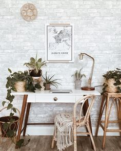 Gorgeous bohemian style office with faux brick wall using temporary wallpaper - styled by This Haus of Ours