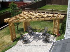 3 post pergola.  Structure appears somewhat overdone, but likely because patio is quite small relative to it