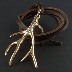 Purchased for me by my clever sister who checked my pins for something I might like for Christmas. Xoxo  Antler Necklace Bronze Antler Pendant on Leather by LostApostle