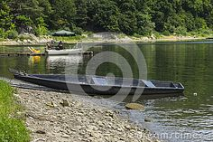 Old boat on the Shore of the Lake in Roznow in Poland .