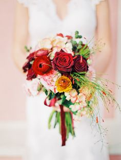 Elegant touches of red roses: http://www.stylemepretty.com/collection/2319/