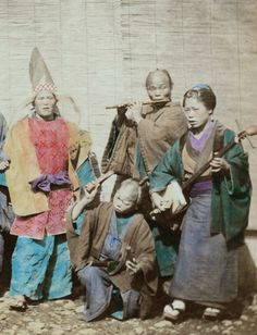 Street performers.  Hand-colored photo, 1870's, Japan, by photographer Felice Beato