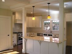 Kitchen Island Ideas With Support Posts great example of support columns via amie corley interiors and the