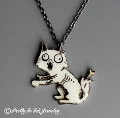Hey, I found this really awesome Etsy listing at http://www.etsy.com/listing/62379143/zombie-kitty-necklace