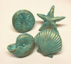 drawer pulls knobs seashells starfish sand dollar nautilus nautical aqua ocean blue brass base beach set