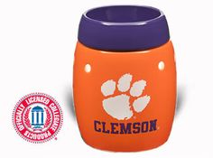 """Clemson University ~ Your football stadium is nicknamed """"Death Valley"""". Clemson fans are lucky enough to have bragging rights in basketball, baseball, soccer, golf, tennis—not to mention one of the most storied rivalries in the history of American sports. A portion of the proceeds from this officially licensed product goes to the university.   Campus Collection Warmer ~ $35. Purchase at www.bonniebuckhalt.scentsy.us"""