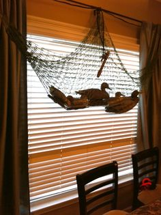 Hunting theme birthday party for my 5 yr old! Took my hubby's decoy net and duck decoys hung then up in the window