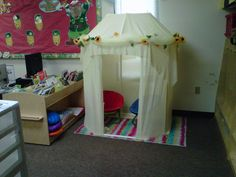This is a reading center tent made from pvc pipe and covered with sheer material. Make a cute cozy corner that kids love.