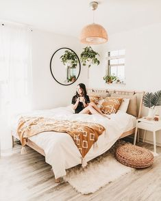 This bedroom design looks like the perfect idea for my next home remodel! Love how the pretty master bed anchors the space while white walls and cute decor complements the look so perfectly!