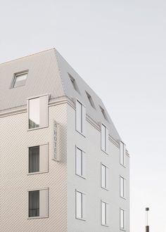 Von M clads carbon-neutral Hotel Bauhofstrasse in white shingles