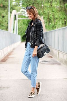 Shop this look for $130:  http://lookastic.com/women/looks/biker-jacket-and-tank-and-boyfriend-jeans-and-crossbody-bag-and-low-top-sneakers/2964  — Black Leather Biker Jacket  — Black Crochet Tank  — Light Blue Boyfriend Jeans  — Black Quilted Leather Crossbody Bag  — Tan Leopard Suede Low Top Sneakers