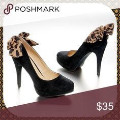 "(Ships on 6/15) Black Faux Suede Leopard Bow Pumps Pre-Order! This item will be shipped by 6/15. Thank You! .  Brand New in Box! Gorgeous Black Faux Suede Pumps with flirty leopard-print fabric bow at the heel! These shoes have a wrapped 3.5"" heel with a 0.5"" platform lift. Man-made materials. Size 6M. Limited quantities. Cute shoes! Shoes Heels"