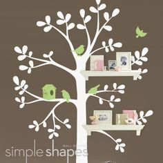 This is the decal in Evan's nursery. The  wall is sherbet orange, the tree latte brown and the birds key lime pie. Then I bought white shelves at Target and voilà!