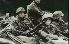 Waffen-SS soldiers driwing with Schwimmwagen. France 1944