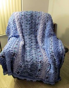 Deep blues make the Alaskan Blue Tunisian Crochet Blanket stand out from the crowd. This intermediate crochet pattern features a gorgeous geometric design in shifting hues of blue. Try the popular Tunisian crochet stitch with this free crochet blanket pattern and you won't be disappointed with the results. Accented with picots and long stitches.