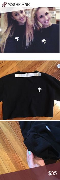 Black Brandy Melville alien crew neck Black Brandy Melville Nancy alien patch crew neck! Flaw- tag missing! Perfect condition otherwise. Sold out in stores and proofs are from my Instagram sorry! Brandy Melville Tops Crop Tops