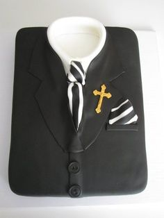 baby #2/4 Boys confirmation suit cake with different ties/handkerchiefs.