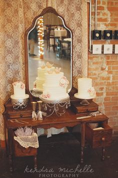 Vintage wedding cake on an old vanity Josh + Jenna Wedding Day, photo by: Kendra Michelle Photography