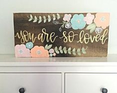 Size: 24 wide by 12 tall Details: This listing features a stained wood background with lightly distressed edges. Hand painted flowers featured in mint, coral, and blush pink with gold and white accents and gold hand painted lettering featuring the quote Painted Letters, Hand Painted, Painted Wood, Just In Case, Just For You, Nursery Room, Nursery Signs, Baby Girl Nursery Decor, Wood Nursery