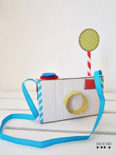 Cute DIY camera using cardboard, washi tape & buttons. #craftykids #craftforkids #imaginativeplay