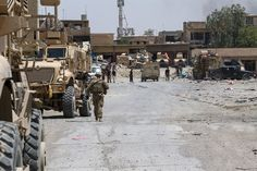 U.S. soldiers deployed in support of Combined Joint Task Force Operation Inherent Resolve and assigned to the 2nd Brigade Combat Team, 82nd Airborne Division, meet up with their Iraqi partners in a recently liberated neighborhood in western Mosul, July 2, 2017. Army photo by Staff Sgt. Jason Hull