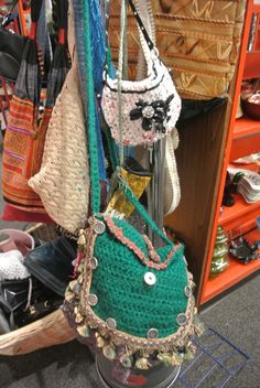 Bookman's, a large used bookstore in Tucson, has expanded to also offer various thrift store style items and they had quite a few crochet purses, including the one in the back there made of plarn.