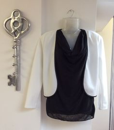 Black ruffle neck vest top £36.00 and white blazer with black edging £28.00 for the smart casual look... - FREE DELIVERY!
