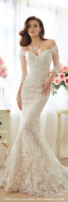 Y11632 – Riona by Sophia Tolli. Off-the-shoulder lace and misty tulle trumpet gown with sheer lace three-quarter length sleeves.  More photos can be found at moncheribridals.com #laceweddingdresses
