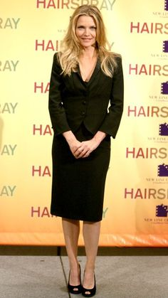 Stars Show You How to Be Stylish & Age-Appropriate with Your Hemline - Michelle Pfeiffer, 56, hit the New York City Hairspray photocall in a chic black skirt suit. The hem of Pfieffer's high-waisted pencil skirt hit at just the right place. We especially admire how she choose a peep-toe pump versus a closed-toe shoe—showing just that much more skin makes her look a bit less conservative.