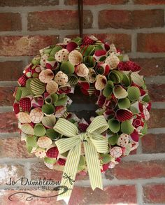 Stampin' 'n Stuff: Christmas Paper Wreath. This link sells the instructions on this wreath. However if you have double sided Christmas paper and some hot glue, make a LOT of cones and glue them in a circle.  Pinning this to give it a try.