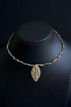 Lost wax casting in brass, tribal design. Thread & brass wire collar.