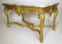 A Very Fine French 19th Century Louis XV Style Gildwood Carved Figural Table with Brêche Violette Marble Top and Hooved Feet. Circa: Paris, 1880