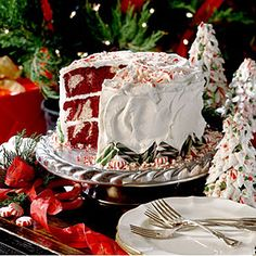 Red Velvet Peppermint Cake   Swirled velvety red-and-white cake layers are topped with a sweet Peppermint Cream Cheese Frosting in this showstopping layer cake.