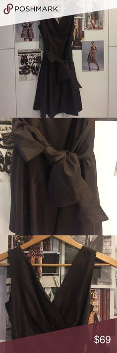 Brown copper dress S Brand new never worn. Figure flattering. Bow detail. There is a layer of fluff under it. Just the right kind and not over the top. 👗 boutique Dresses Midi