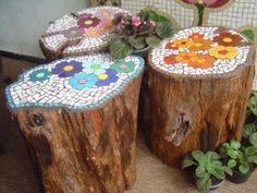 Pretty flower mosaic design on tree stumps. That would make our tree stump stools in the yard much nicer to sit on especially after it rained.