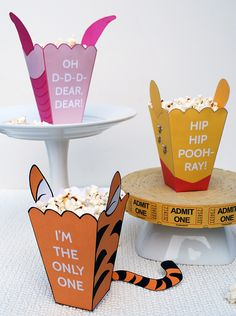 Winnie The Pooh Free Printables Popcorn Boxes for Pooh, Tigger, and Piglet!! Adorable!!!!! So making these when its family movie nite and it's Tori's turn to pick movie!  These were her favorite characters when she was lil!❤