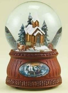 """$44.99-$55.99 From the Glitterdomes Collection Item #35588  Religious glitterdome depicts a horse drawn sleigh ride by a snowy church, sitting upon a detailed base with a vintage-style sleigh ride decal Horse and sleigh rotate around the church  Winds up to play the classic Christmas tune """"The First Noel"""" Comes gift boxed  Dimensions: 6.75""""H x 4.75""""W x 4.75""""D Globe dimensions: 120mm Material(s): ..."""