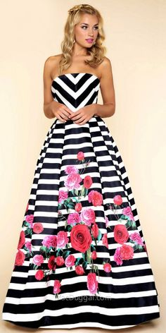 Get ready for your close up on the red carpet when you arrive in this Geometric Striped Rose Print Ball Gown by Mac Duggal. This one of a kind style features a classic strapless modified sweetheart neckline and a geometric fitted bodice. The skirt features a ball gown skirt that includes box pleating and horizontal stripes with a rose floral print for that extra pop. #edressme