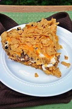 Frito Taco Pie. This Frito pie casserole is an excellent ground beef casserole for a fun weeknight meal. Have some fun with your food!