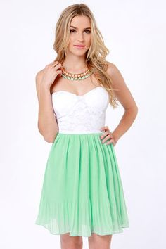 When lace meets pleats with the Pleat Your Case White and Mint Green Dress, you get a look so stunning it speaks for itself! White lace bustier bodice with elastic at back has a sexy sweetheart neckline with lightly padded cups. A pleated mint green chiffon skirt flowing beneath tells the story of nights spent swaying to the music. Lined. $39