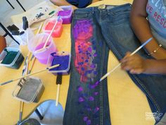One of the hospital's family lounges was transformed to look like an artist's dream, with a multitude of vibrant paints and paint brushes placed throughout the tables and on the floor. Patients and families, along with certified art therapists, had the opportunity to paint canvas tote bags and vintage jeans.  #art #kids #creativity #fun #jeans