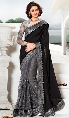 Spread your grace and stylishness wearing this black and gray color net jacquard half n half sari. The lovely lace, resham and stones work throughout attire is awe-inspiring. #blackhalfnhalfsaris #blacksaree #reshamembroideredsari