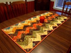 Fall table runner - she used insul-liner instead of batting so her Thanksgiving hot dishes could be put directly on table. Chevron Table Runners, Table Runner And Placemats, Quilted Table Runners, Table Topper Patterns, Quilted Table Toppers, Thanksgiving Table Runner, Fall Table, Fall Sewing, Place Mats Quilted