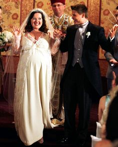 Gossip Girl's Dorota and Vanya Blair Waldorf's loyal maid Dorota (Zuzanna Szadkowski) married doorman Vanya (Aaron Schwartz) in a shotgun ceremony during Gossip Girl's third season in 2010. The very pregnant bride showcased her baby bump in a long-sleeved lace gown, which was custom-made by the show's costume designer Eric Daman.