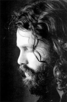 A black and white portrait of a hirsute Jim Morrison of The Doors #jimmorrison #thedoors