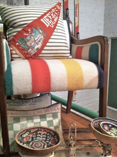 love the pennant pillow and hudson bay blanket on the chair