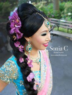 braid floral braid indian wedding fusion chinese indian bride chinese bride indian bride orchid hair pink orchids blue smokey eye colorful bridal