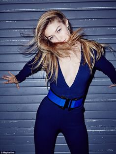 Beautiful in blue!Posing up a storm in the colourful snaps, the 20-year-old model was in her element as she put her incredible curves on display in a plunging navy jumpsuit that showed off her decolletage